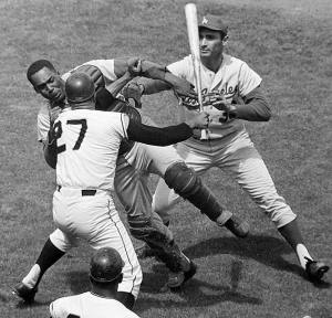 The San Francisco Giants' Juan Marichal takes a bat to Los Angeles Dodgers catcher John Roseboro on Aug. 22,1965. Sandy Koufax pleads for peace.